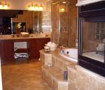 Master Bathroom with Roman tub, walk-in closet, and firplace