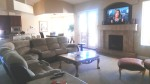 family room, fireplace and large sdreen TV