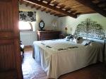 Natural wood ceiling and furniture. Spacious luminous room