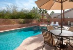 pool area, table, chairs and umbrella